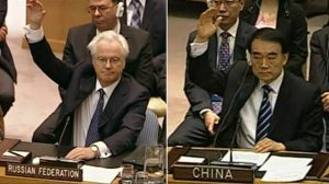 The representatives of Russia and China to the United Nations, Vitaly Churkin and Liu Jieyi, signal the intent of their nations to veto a resolution pertaining to the Syrian Civil War.